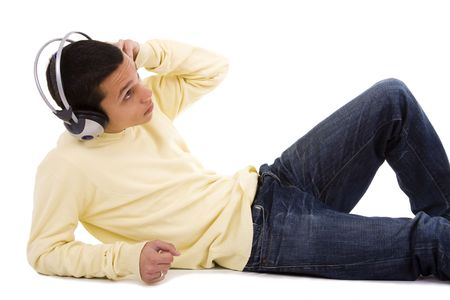 young man lie down on the floor relaxing at the sound of good music Stock Photo - 4088925