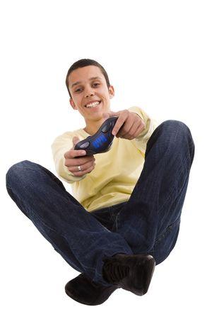 joy pad: young man having fun playing with a joy pad (selective focus)