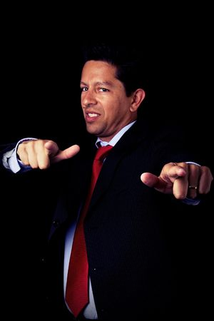 businessman looking powerful and pointing to you (selective focus) Stock Photo - 4159872