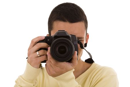 photography session: Young photographer taking a picture with is camera