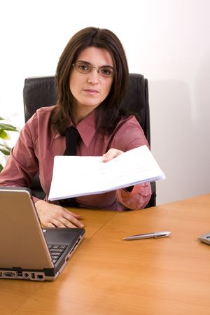 businesswoman working with the computer at her office photo