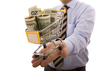 supermarket cash: businessman holding a shopping cart full of money (selective focus) Stock Photo