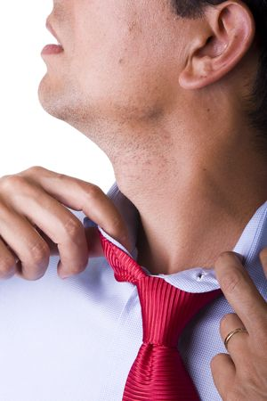 businessman adjusting his necktie in a day of great stress photo