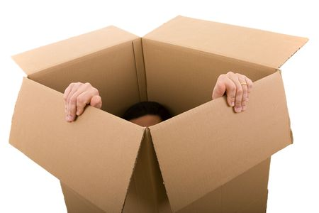 men trying to escape from a cardboard box (selective focus) photo