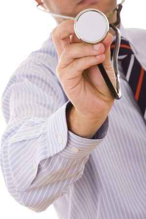 stethoscope in the doctor hand pointing to you (selective focus) photo