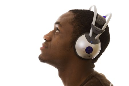african young men enjoying some music in the headphones (isolated on white) photo