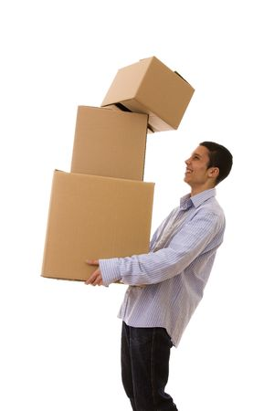 young man holding a stack of package parcels (isolated on white) photo