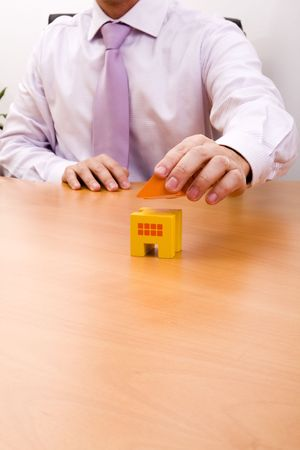 businessman selling a new house at his office (selective focus) Stock Photo - 4465925