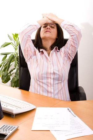 businesswoman at her office stressed with her work Stock Photo - 4460079
