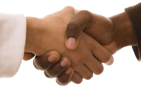 black handshake: multiracial handshake from an african and a caucasian mens hand (isolated on white)