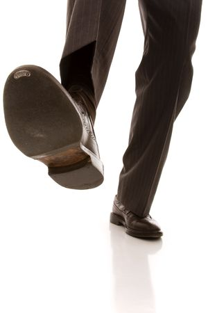 shoe and leg of a businessman caution step (selective focus) Stock Photo - 4465922