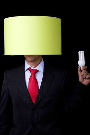 businessman holding a lamp (it's not his idea) photo