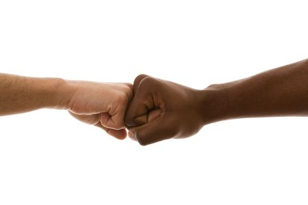 racism: multiracial fist to fist agreement (isolated on white) Stock Photo