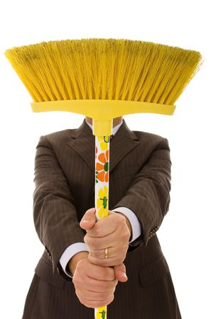 businessman holding a cleaning broom (selective focus) photo