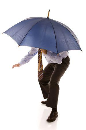 businessman hiding under a blue umbrella (isolated on white) photo