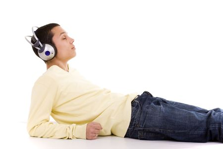 young man lie down on the floor relaxing at the sound of good music Stock Photo - 4572281