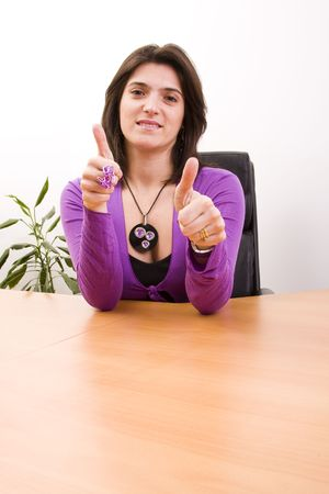 businesswoman gesturing OK with her hands at the office photo