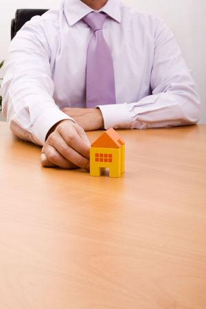 businessman selling a new house at his office (selective focus) Stock Photo - 4666345