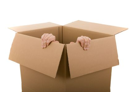claustrophobia: men trying to escape from a cardboard box (selective focus)