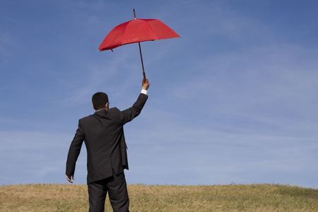 Businessman finding protection outside in the field Stock Photo - 4666344