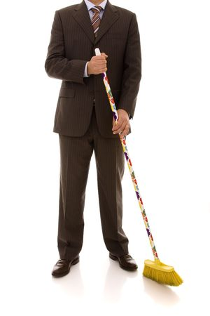 floor standing: businessman holding a cleaning broom (isolated on white)