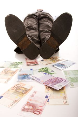 rich businessman relaxing over a lot of money (selective focus) photo
