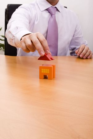 businessman selling a new house at his office (selective focus) Stock Photo - 4756296