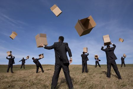 a group of businessmans in the field with cardboard boxes (some motion blur on fast movement) photo