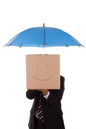 businessman holding a umbrella and a cardboard box with a smile face (selective focus) photo