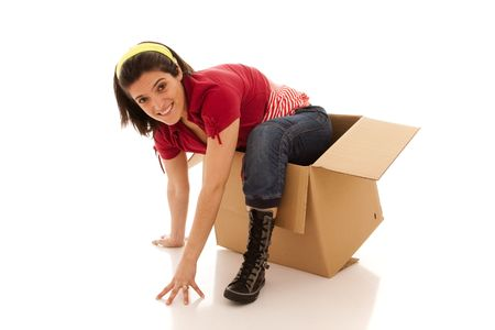 out of the box: young woman leaving from a cardboard box Stock Photo