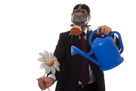 a businessman with a gas mask holding a artificial flower from the future  photo