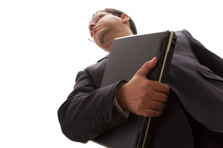 bellow perspective of a confident businessman carrying a laptop (selective focus)  photo