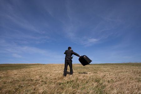 businessman with his luggage outdoor in the field Stock Photo - 4842223