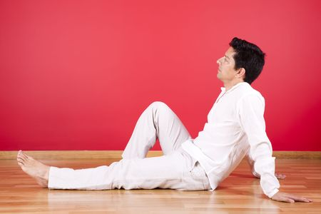 young men sited in the floor of his new house Stock Photo - 4892331
