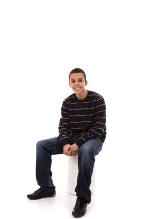 smilling: young man seated in a bench smilling Stock Photo