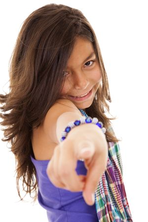 ten year beautiful girl smiling and pointing to you (selective focus) photo