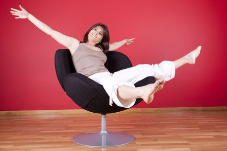 young woman enjoying her new house, on her couch Stock Photo - 5109218