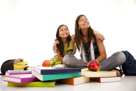 two young student sisters reading books on the floor photo