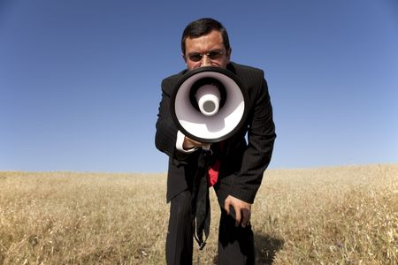 businessman at the field shouting at the megaphone to you Stock Photo - 5109245