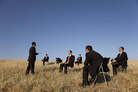 teaching adult: business outdoor training, with a presentation for a group of businesspeople Stock Photo