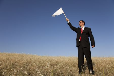 businessman asking for surrendering with a white flag Stock Photo - 5109359