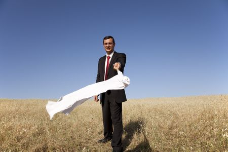 businessman asking for surrendering with a white flag (selective focus) Stock Photo - 5109394