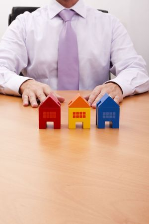 businessman selling a new house at his office (selective focus) Stock Photo - 5105264
