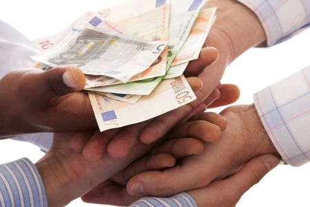 african solidarity: multiracial hands united to receive the money (isolated on white)