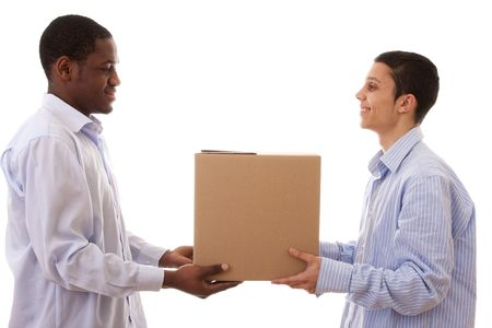 african and caucasian men holding cardboard box  Stock Photo - 5133785