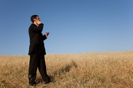 contryside: businessman talking at his cellular in the outdoor