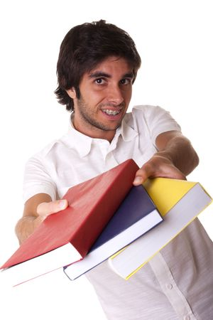 young student giving you colorful books (isolated on white) photo