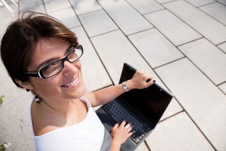 young businesswoman working with her laptop outdoor Stock Photo - 5521081