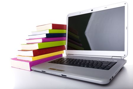 Colorful books next to a modern laptop Stock Photo - 5465505