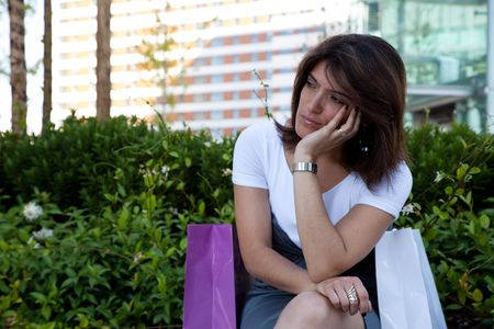 after shopping: unhappy woman after shopping, something very strange